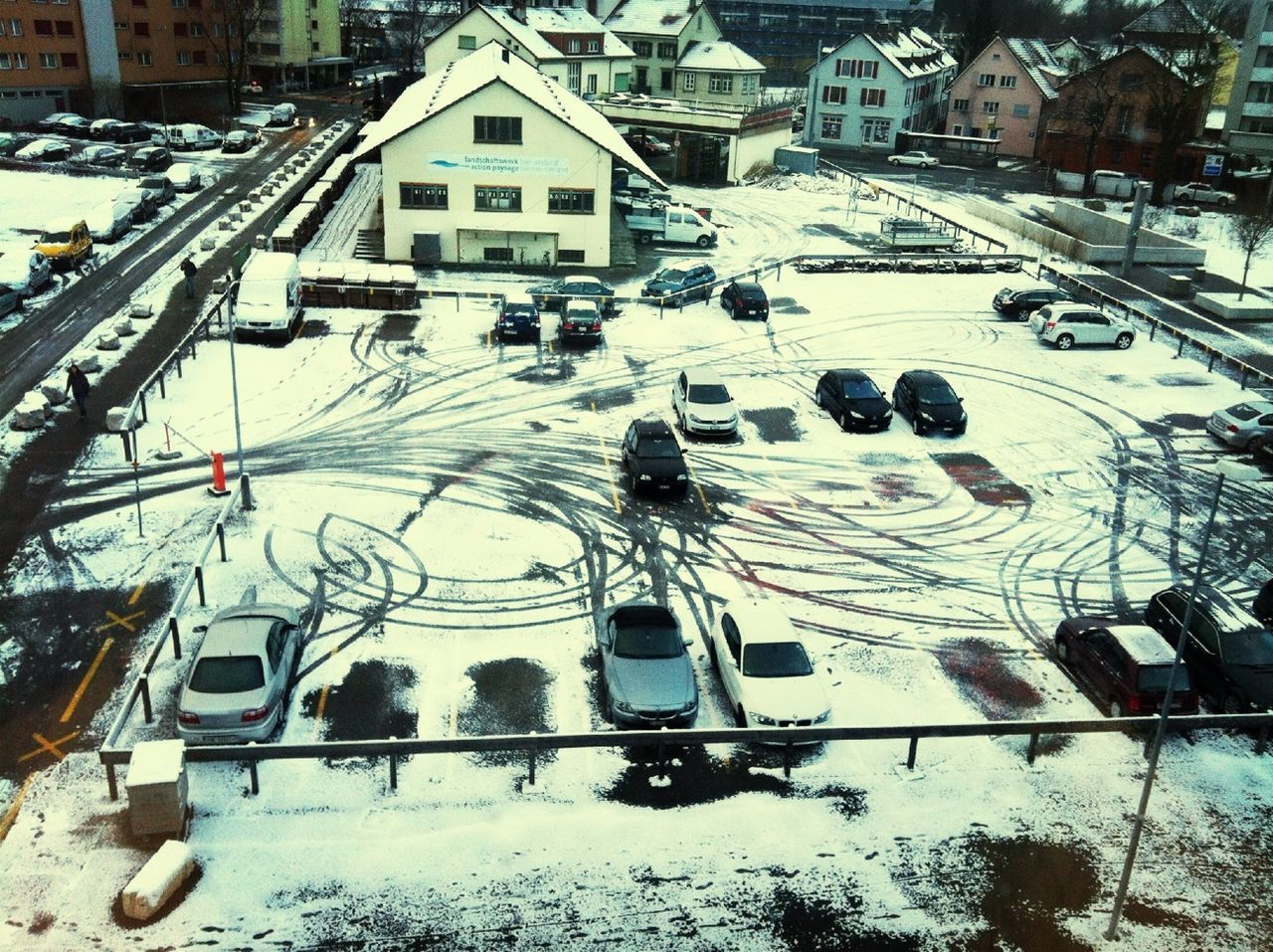 snow, winter, cold temperature, high angle view, transportation, outdoors, day, mode of transport, no people, nature, building exterior, city