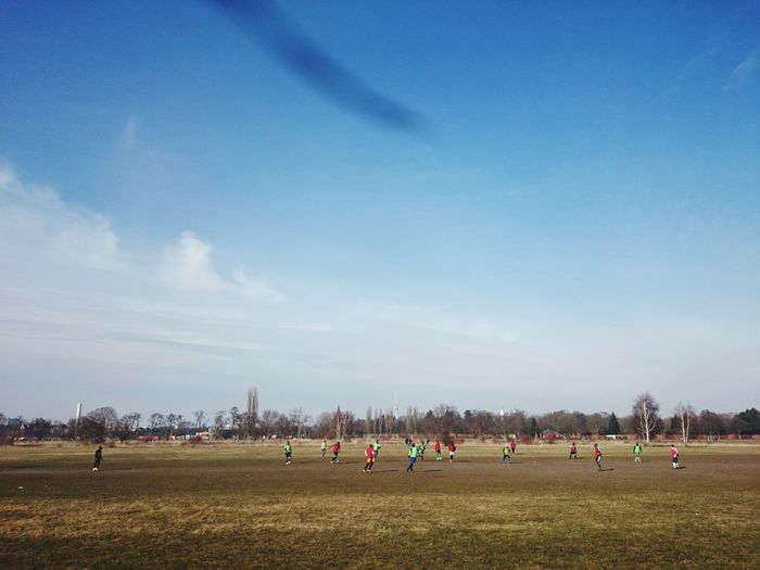Soccer players playing on field