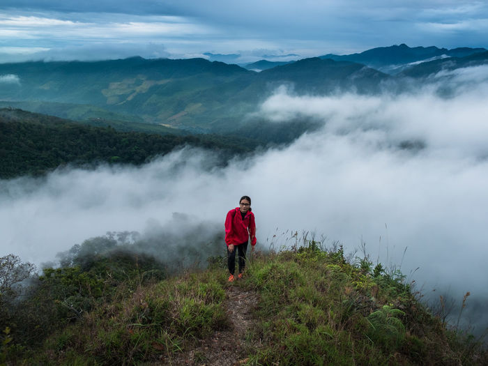 Beauty In Nature One Person Scenics - Nature Real People Mountain Leisure Activity Non-urban Scene Sky Standing Cloud - Sky Rear View Fog Full Length Casual Clothing Nature Tranquil Scene Lifestyles Tranquility Idyllic Mountain Range Looking At View Outdoors Hiking Travel Travel Destinations