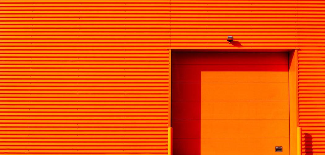 Closed red door of building