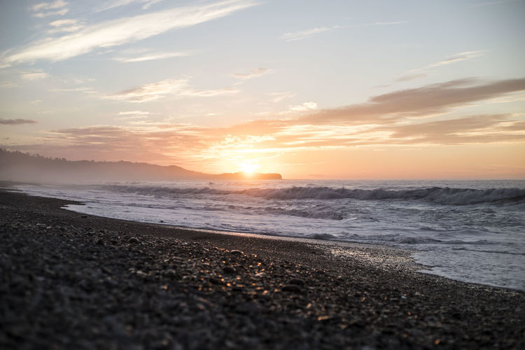 A beautiful sunset in Gillespie beach, New Zealand. Sunset_collection Beach Beauty In Nature Cloud - Sky Coast Horizon Horizon Over Water Idyllic Land Motion Nature No People Ocean Orange Color Outdoors Scenics - Nature Sea Sky Sun Sunset Tranquil Scene Tranquility Water Wave