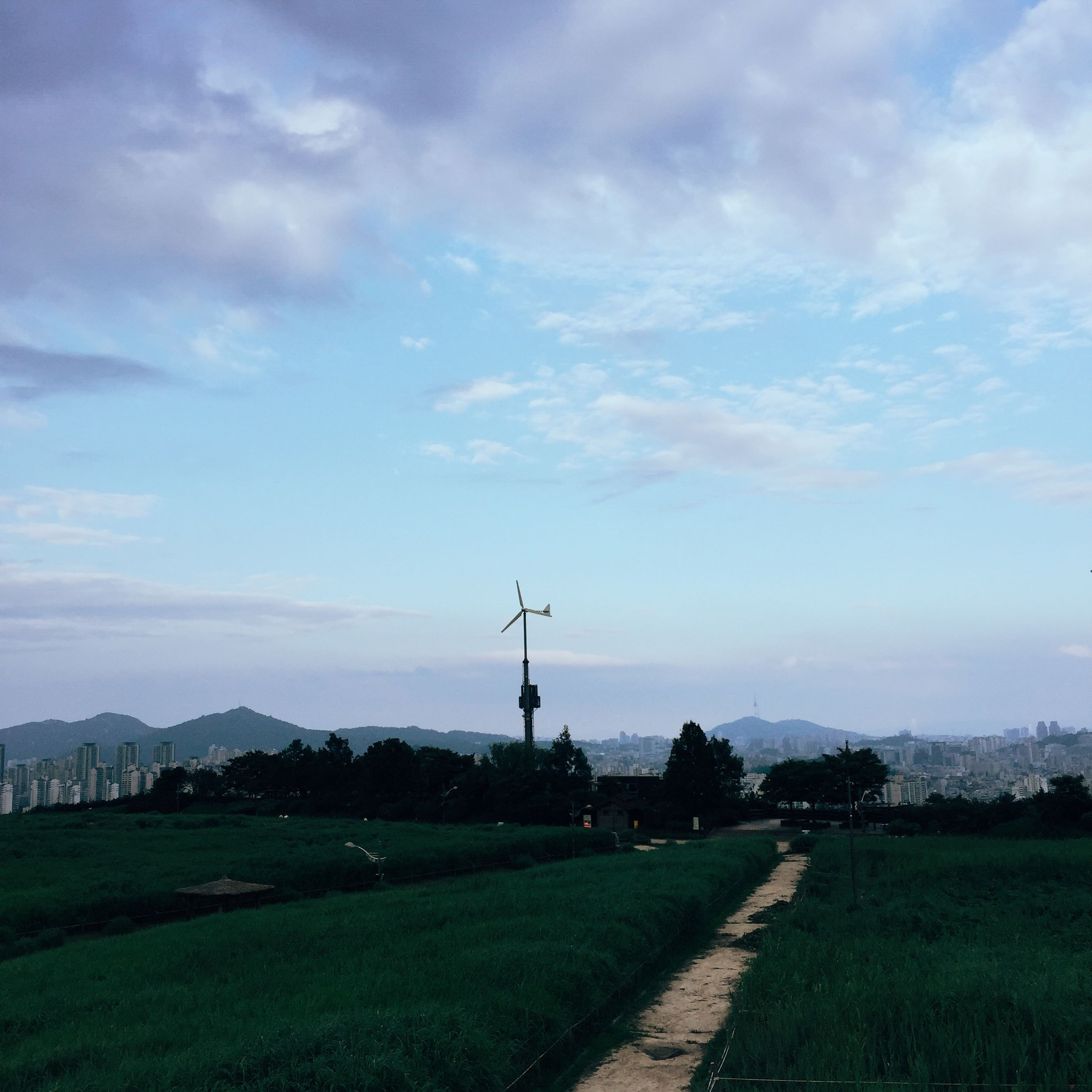 sky, field, landscape, wind power, wind turbine, alternative energy, cloud - sky, grass, built structure, windmill, fuel and power generation, building exterior, renewable energy, environmental conservation, rural scene, architecture, cloudy, cloud, nature, traditional windmill