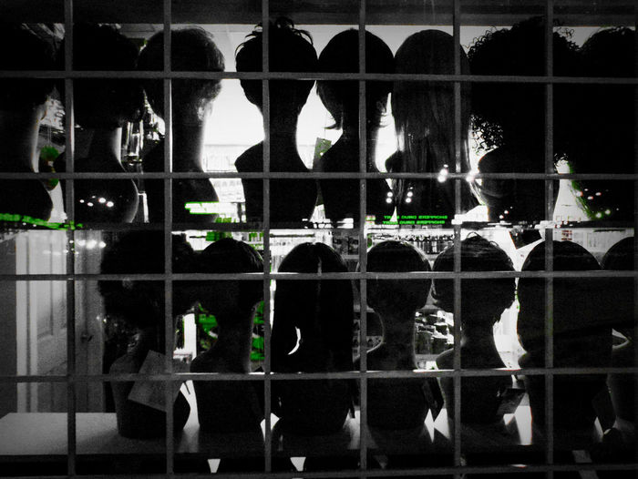 heads Abstract Arrangement Art Black And White Floating Heads Green Heads Light Reflections Mannequin Night Photography Silhouettes Storefront Street Photography Street Reflections Window Window Bars
