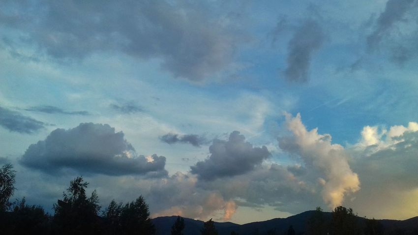 Beautiful Sky And Clouds Beauty In Nature Tranquility No People Skyscape Multicolored Sky Tree Mountain Blue