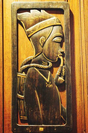 Close-up of statue against door