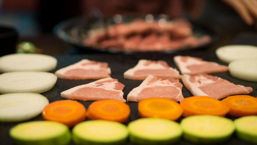 Slices Of Meat With Vegetables On Table