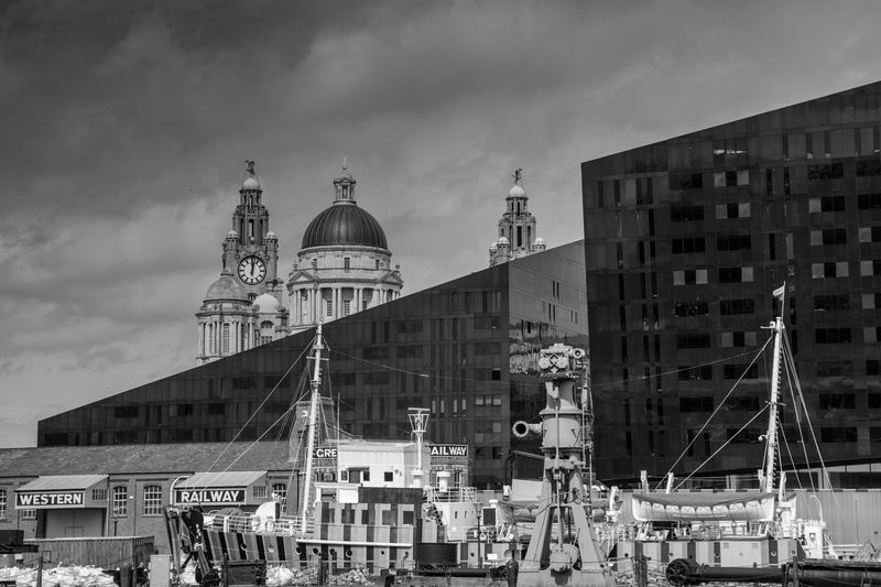 Liverpool Cityscape Liver Birds Liver Building Liverpool England Liverpool Waterfront Liverpool Docks Pier Head Liverpool Architecture Black And White Black And White Photography Boats Building Exterior Built Structure City Cloud - Sky