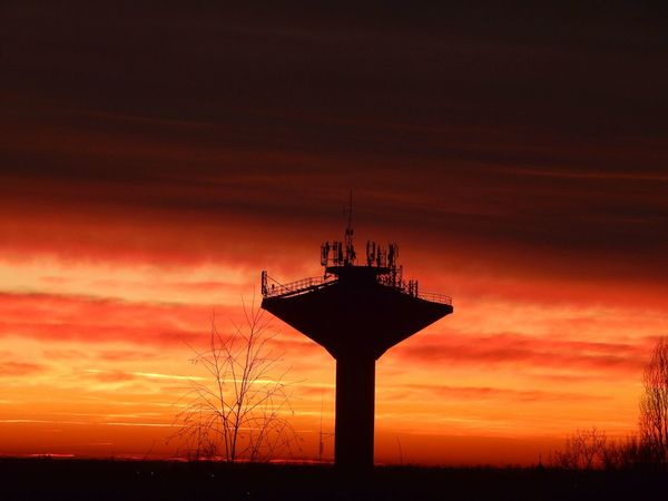 Red sky at sunset with a water tower. Cloud Cloud - Sky Dramatic Sky Moody Sky No People Orange Color Rural Scene Silhouette Sky Sunset Tranquility