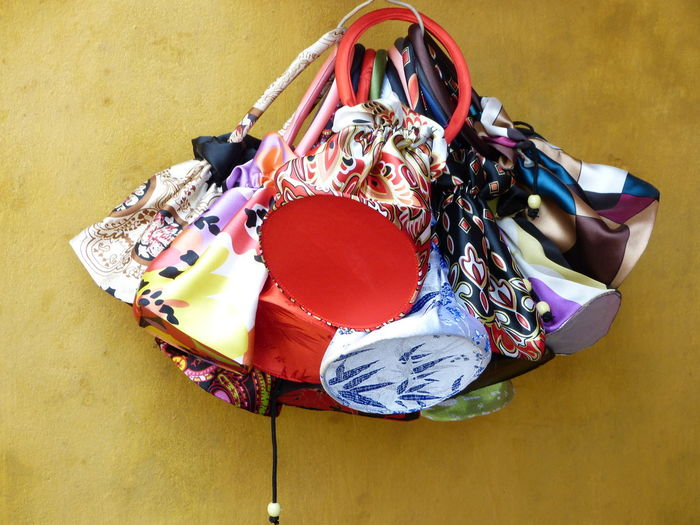 High angle view of colorful pouch hanging by wall