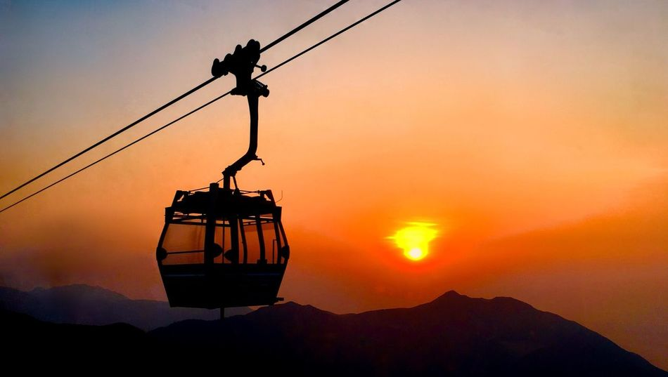 Ngong Ping 360. By SONY Xperia Z5. Cable Car Hong Kong Lantau Island Sunset_collection Beauty In Nature Cable Day Hanging Mountain Nature No People Orange Color Outdoors Overhead Cable Car Scenics Silhouette Ski Lift Sky Sunset Technology Tranquility Transportation Water