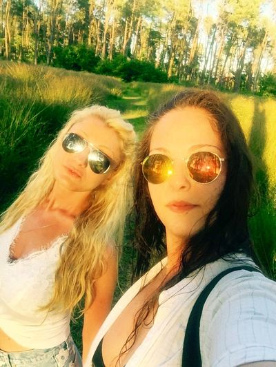 Hello World Summer2016 Friendship Enjoying Life Hot Day Vacations Sunglasses Green Green Green!  Long Hair Nature Friends Summertime Color Of Nature Life Is Beautiful Girls Us Blonde And Brunette Selfie ✌ In Nature  Walking Color Of Life Sunshine ☀ Trees Holidays Long Trees