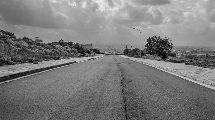 Sky Transportation Road The Way Forward Cloud - Sky Direction Nature Day City Architecture No People Diminishing Perspective Built Structure Building Exterior Street Tree Outdoors vanishing point Street Light Concrete Blackandwhite Black And White EyeEm Best Shots EyeEm Selects Clouds And Sky