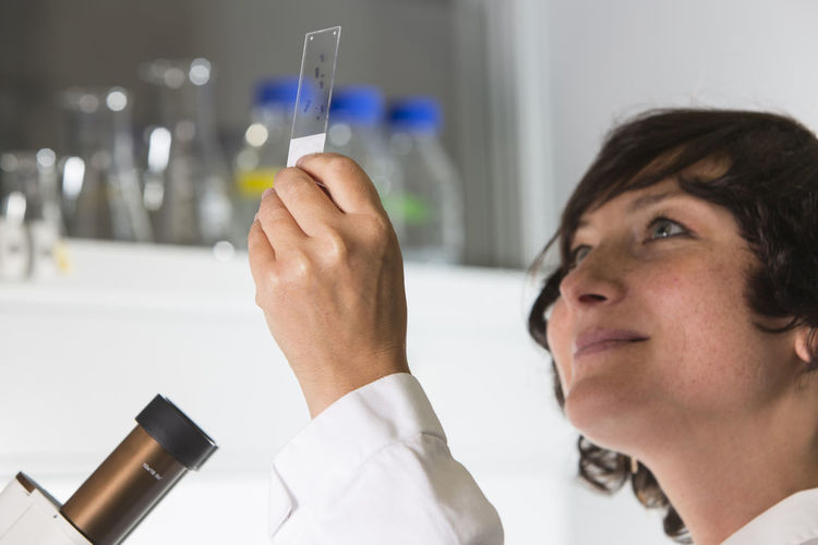 Close-up of woman analyzing chemical in laboratory