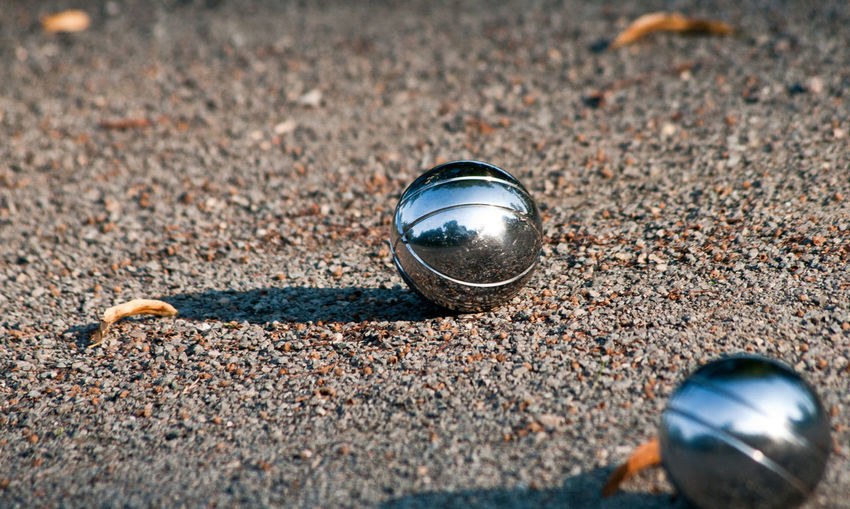 Close-up of metallic marbles on ground