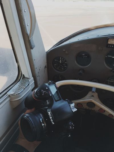 High angle view of camera seen through airplane