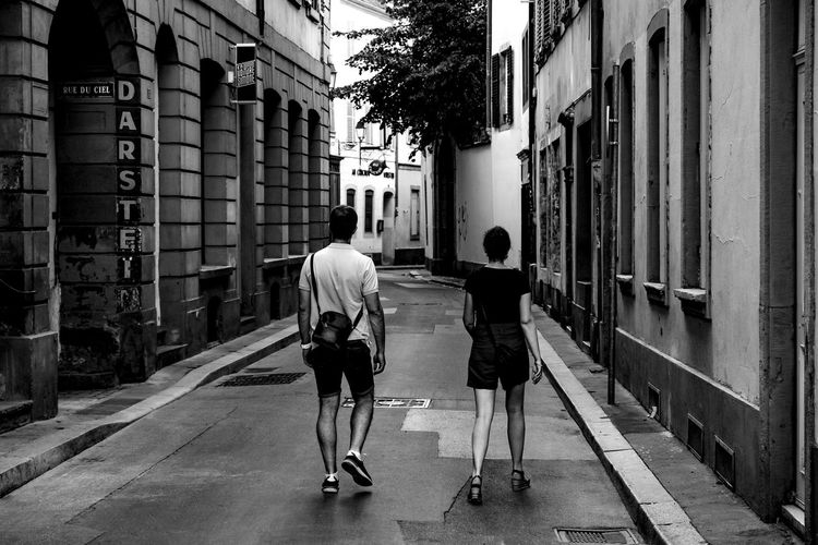Bloody Tourists ... Urban Perspectives Street Photography Black & White Monochrome Black And White Road The Way Forward Architecture Building Exterior City Built Structure Full Length Real People Walking Rear View Street Men Building People Footpath Lifestyles City Life Adult Women Two People Transportation Day The Devil's In The Detail The Street Photographer - 2019 EyeEm Awards