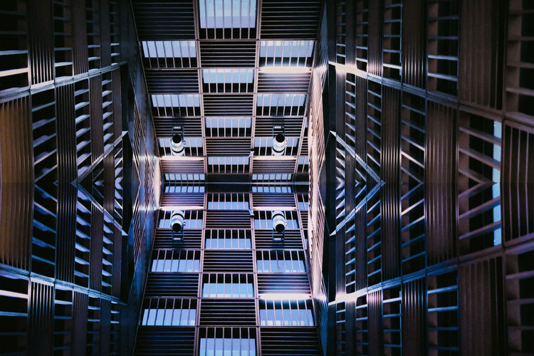 Low angle view of escalators skylight in city