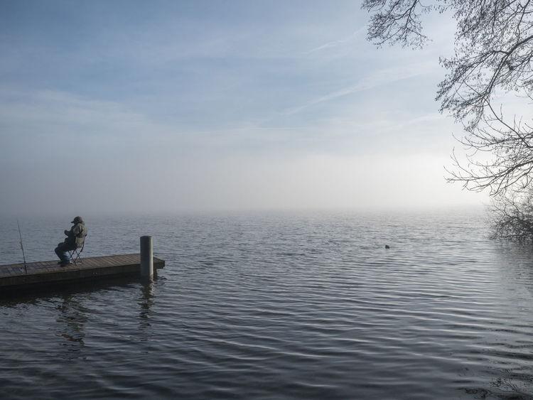 #Fisherman #fog #Lake #reed
