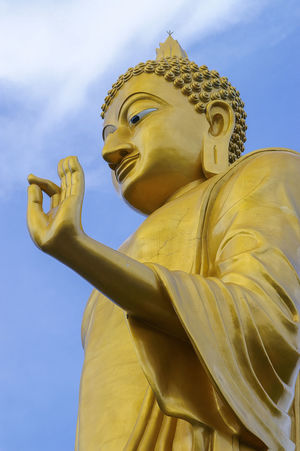 Big buddha statue in Thailand at Chiang khan, Loei Province,Thailand Big Buddha Chiang Khan Thailand Loei Belief Big Buddha Statue Chiang Khan Creativity Gold Colored Human Representation Low Angle View Outdoors Place Of Worship Religion Representation Sculpture Sky Spirituality Statue Statue
