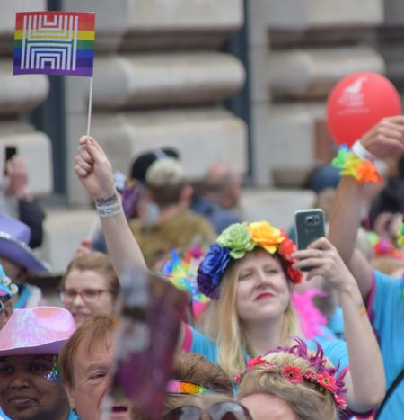 Hull 2017 volunteer takes a selfie during UK Pride parade as part of Hull UK City of Culture 2017 (22nd July 2017) Hull Hull City Of Culture 2017 Pride In Hull UK Pride Celebration Crowd Day Enjoyment Friendship Happiness Holding Hull 2017 Large Group Of People Lifestyles Mobile Phone Multi Colored Outdoors Photographing Pride Parade Real People Selfie Smart Phone Technology Togetherness Wireless Technology