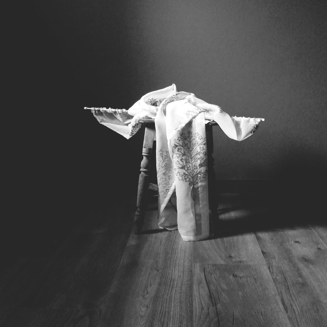 indoors, no people, representation, still life, flooring, wood, hardwood floor, wood - material, wall - building feature, animal body part, human representation, art and craft, textile, mammal, creativity, close-up, hanging, body part