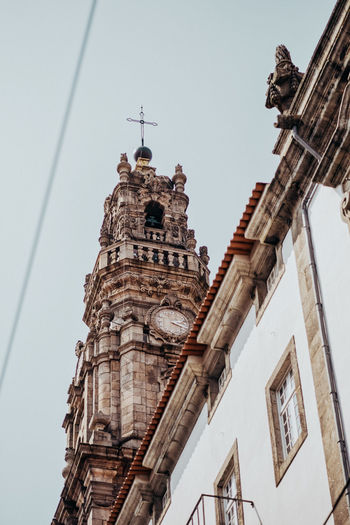A Great Place in Porto Porto Porto Portugal 🇵🇹 City Tower Portugal Warm Colors Architecture Built Structure Building Exterior Low Angle View Building Sky Religion History Spirituality Day Place Of Worship Belief The Past Nature No People Clear Sky Travel Destinations Clock Outdoors Spire  Gothic Style