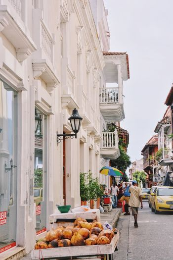 "Also known as ""La Fantástica"". Architecture Building Exterior Cultures City Built Structure People Cartagena Colombia Colonial Architecture Streetphotography Street Urbanity Urban Lifestyle Urban White Buildings Street Vendor Tourist Tourist Attraction  Tourism"