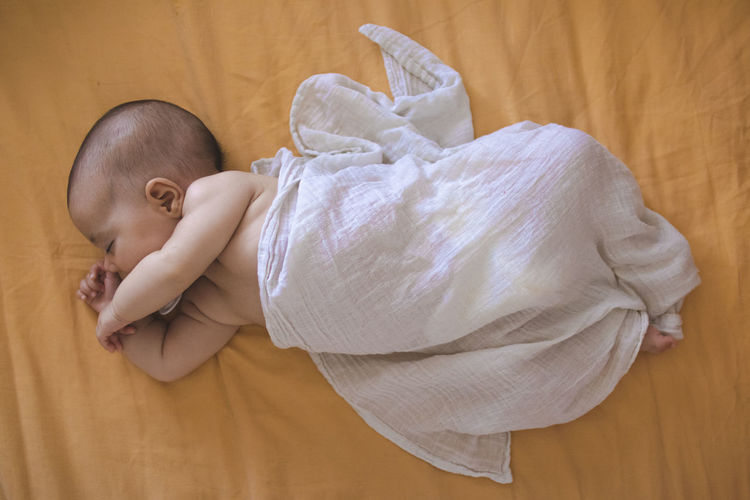 High angle view of cute baby sleeping at home