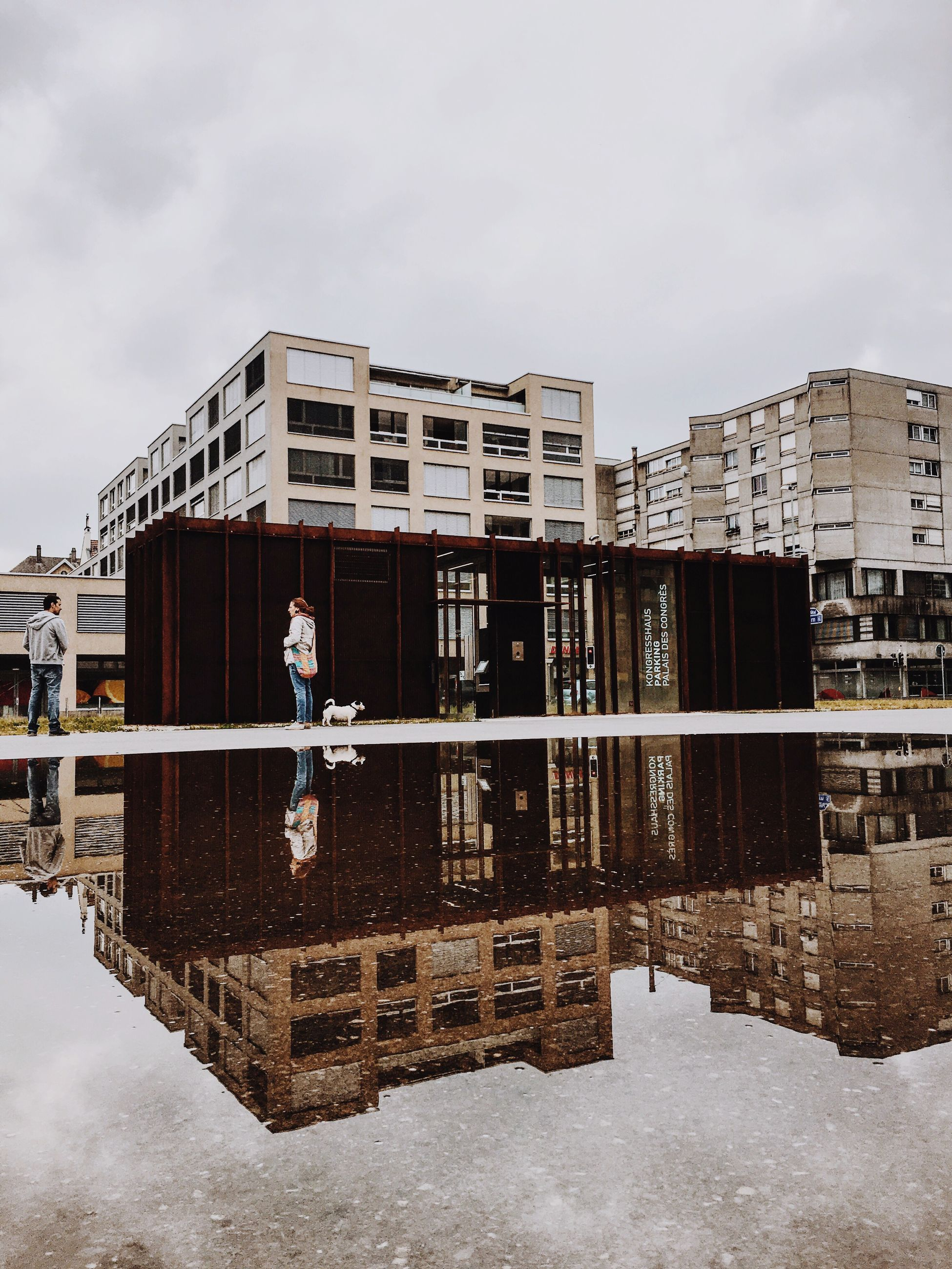 reflection, water, architecture, building exterior, built structure, waterfront, residential building, residential structure, city, building, calm, sky, standing water, river, cloud, day, outdoors, office building, no people, residential district, modern