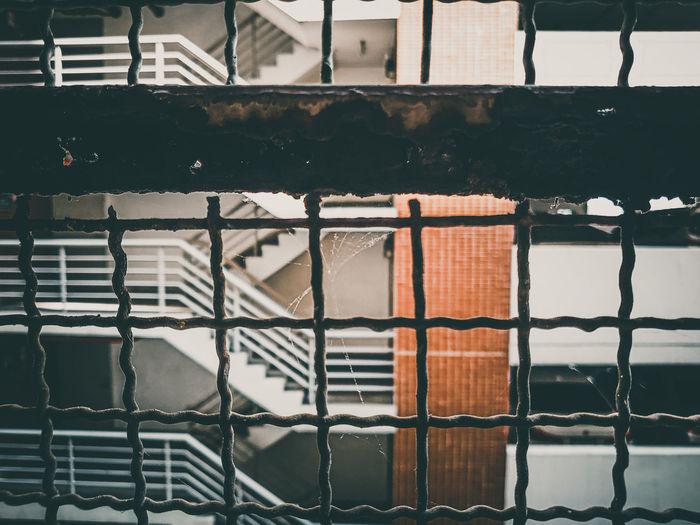 Full frame shot of metal grate on building