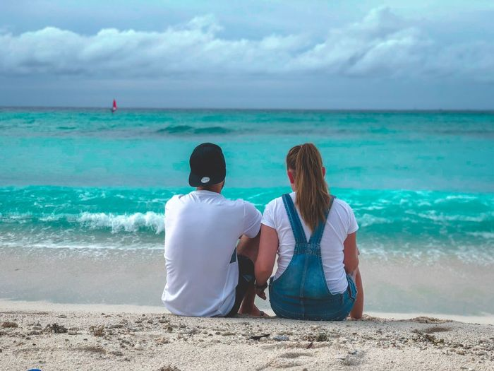 Sea Water Land Beach Rear View Sky Two People Togetherness Beauty In Nature Leisure Activity Horizon Scenics - Nature Sitting Nature Women Couple - Relationship Real People Horizon Over Water Lifestyles Outdoors Moms & Dads