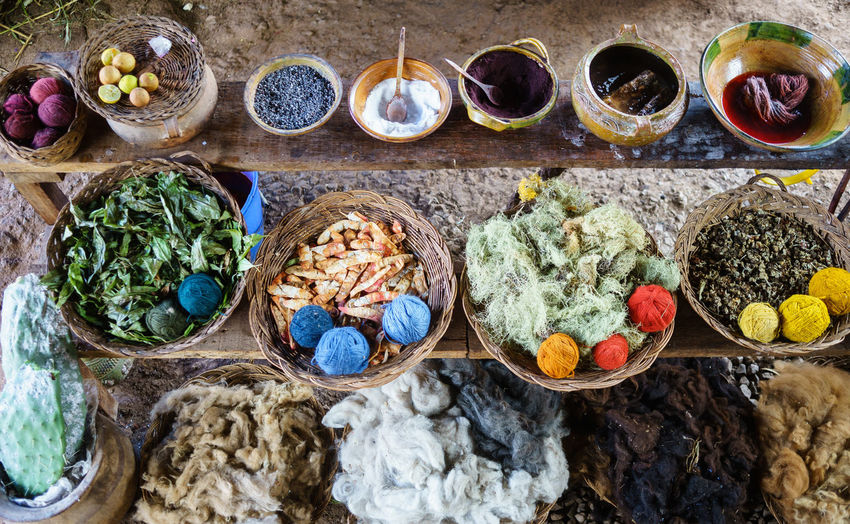 High angle view of various spices and cotton in whicker basket