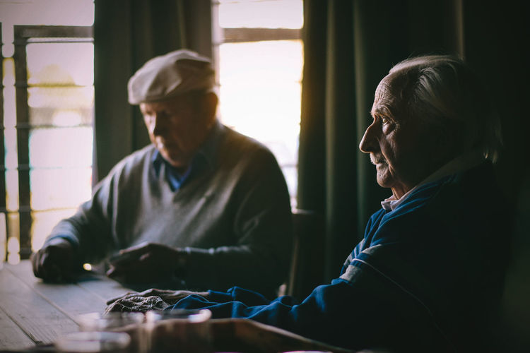 Adult Day Indoors  Mature Adult People Real People Sitting Technology Togetherness Two People