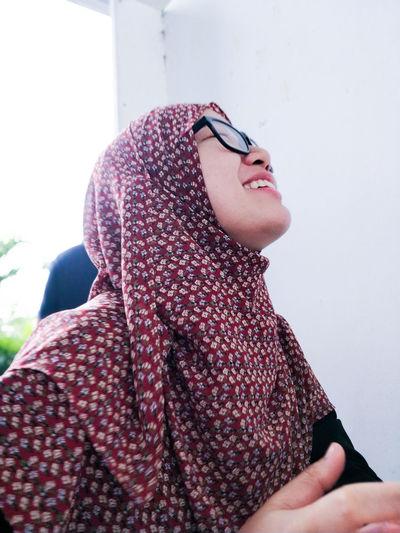 Smiling woman wearing eyeglasses and hijab