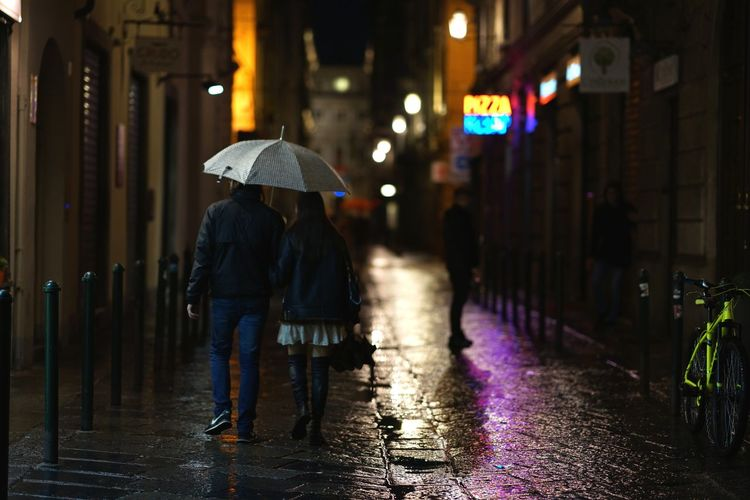 Rain in the street Umbrella Urban Night Walking Sidewalk Streetphotography Transportation City Full Length Women Wet Protection Street Young Women Illuminated Water Rain