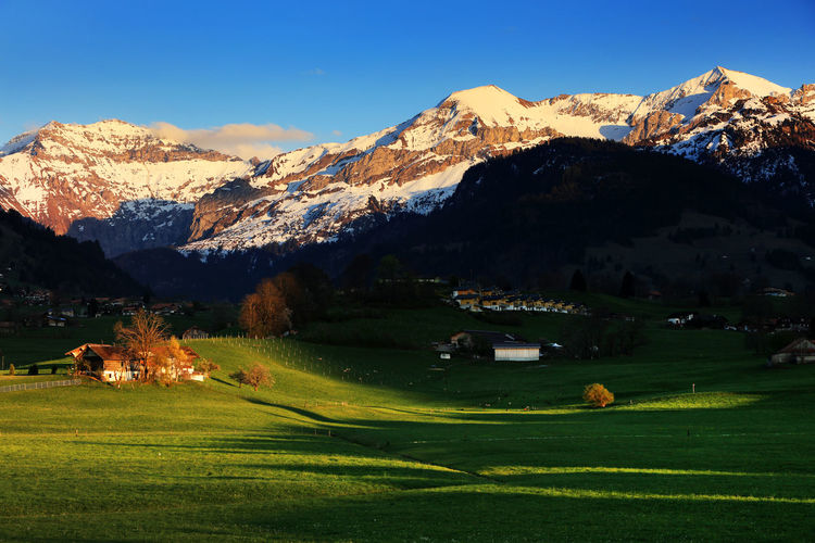 Scenic view of snowy mountains against sky
