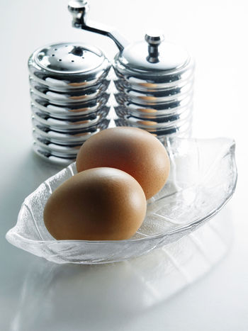 half boiled egg as breakfast Breakfast Cooking Diet Easter Natural Nature Salt And Pepper Close-up Egg Food Food And Drink Fragile Fresh Freshness Half Boiled Eggs Indoors  Ingredient No People Nutrition Organic Protein Shaker Shell Studio Shot White Background