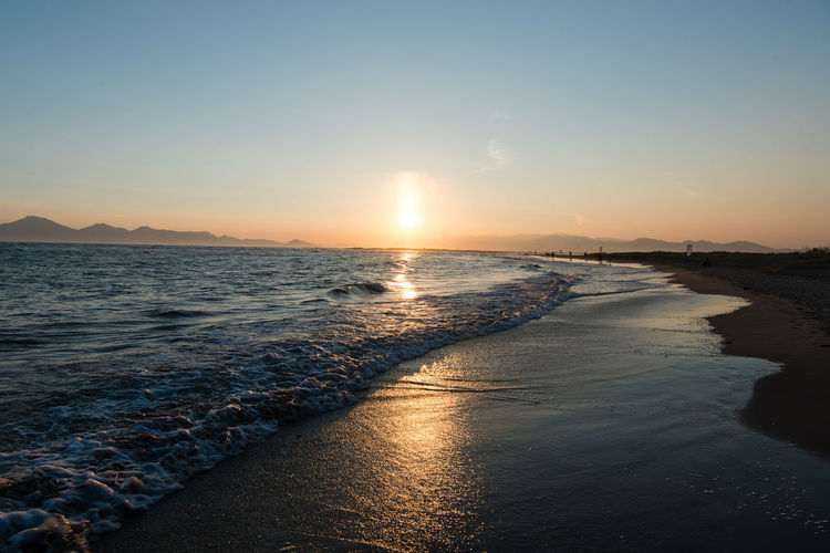 Beach Beauty In Nature Idyllic Land Motion Nature No People Non-urban Scene Outdoors Reflection Scenics - Nature Sea Sky Sunlight Sunset Tranquil Scene Tranquility Water Wave