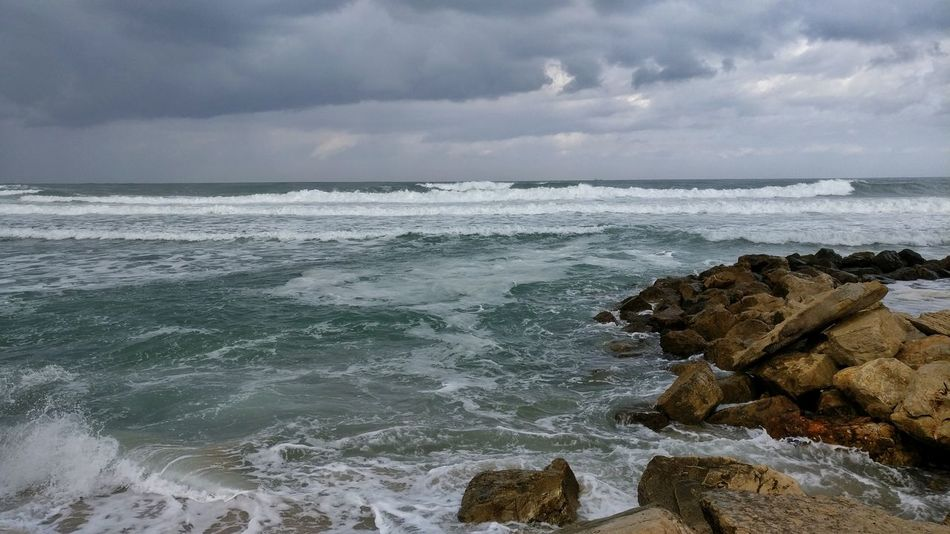 Hypnotized by the Sea No People Storm Cloud Nature Landscape Beauty In Nature Beach Outdoors Day Waves Waves, Ocean, Nature Waves Crashing Surfers Waiting For Waves Surferslife Seaview Horizon Over Water Sky Water Splashing Pattern Traveling Photography MomentsToRemember Wickitravels in Haifa Israel