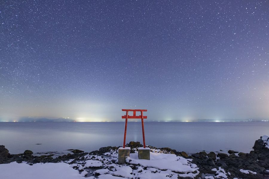 Winter Snow Night Star - Space Sea Sky Horizon Over Water Nature Rock - Object Beauty In Nature Galaxy Water No People Cold Temperature