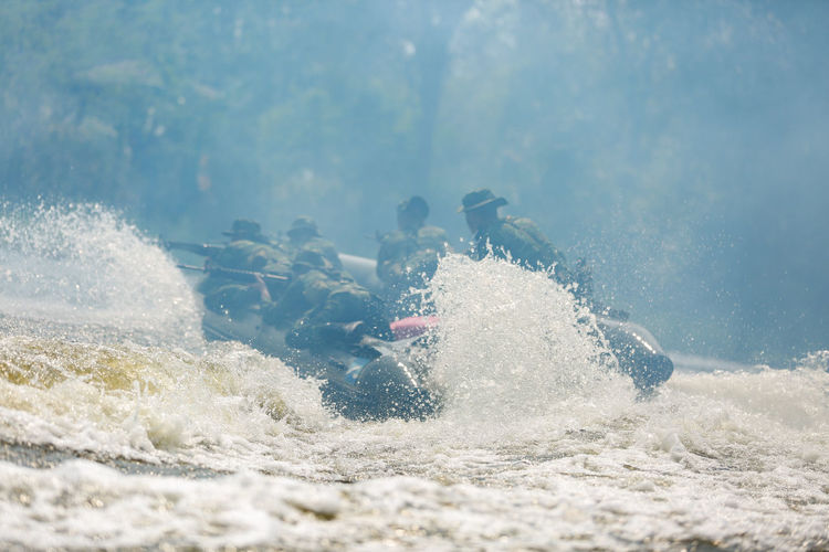 Army soldiers river rafting