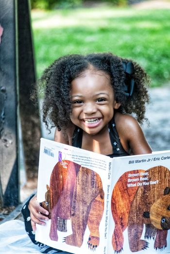 Reading gets funny sometimes! Smiling Happiness Childhood One Person Child Children Only Toothy Smile Cheerful One Girl Only Leisure Activity Looking At Camera Real People Outdoors Portrait People Day