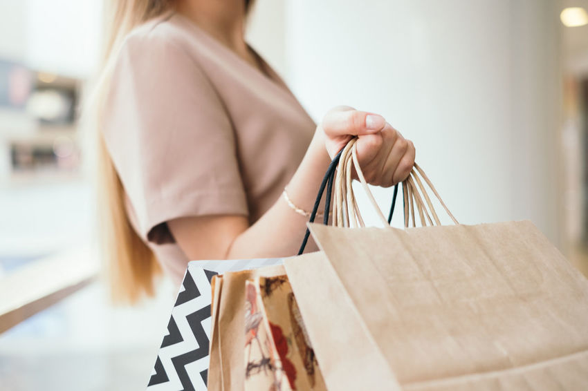 Female hand holding shopping bags Female Hand Shopping Bag One Person Women Bag Black Friday Sale Black Friday Fashion Focus On Foreground Young Adult Young Women Casual Clothing Shopping Mall Consumerism Shopping Retail  Customer  Lifestyles Holding Midsection Wardrobe Sale Carrying