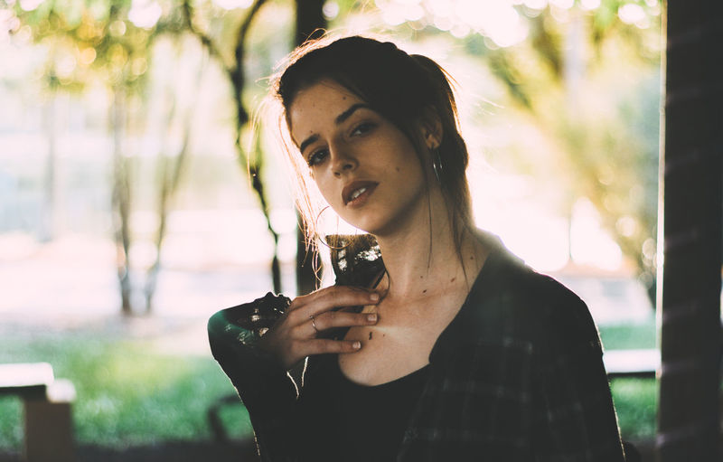 One Person Portrait Real People Front View Young Adult Focus On Foreground Headshot Lifestyles Food And Drink Holding Looking At Camera Leisure Activity Young Women Day Beautiful Woman Beauty Adult Waist Up Casual Clothing Hairstyle Outdoors Glass Drinking Contemplation