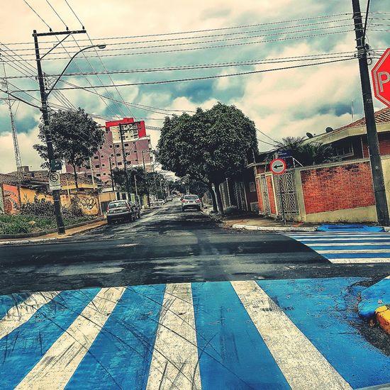 The Street Photographer - 2017 EyeEm Awards Outdoors Ruas Rua Street Streetphotography Azul Blue Day Sky Cloud - Sky No People Tree