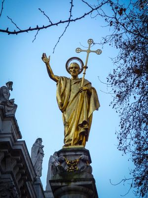 Statue Sculpture Low Angle View Human Representation Male Likeness Art And Craft Sky Gold Outdoors Built Structure Clear Sky Gold Colored Religion City Travel Destinations Spirituality No People Architecture Building Exterior Angel Tree Bare Tree Branches And Sky Out And About London