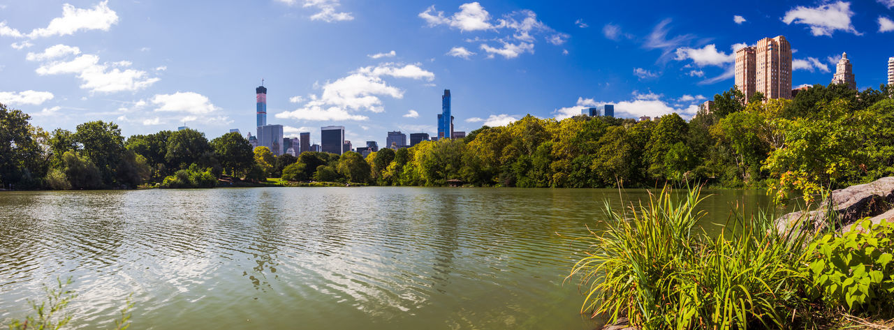 Panoramic View Of Lake And Trees Against Sky In City On Sunny Day At Central Park