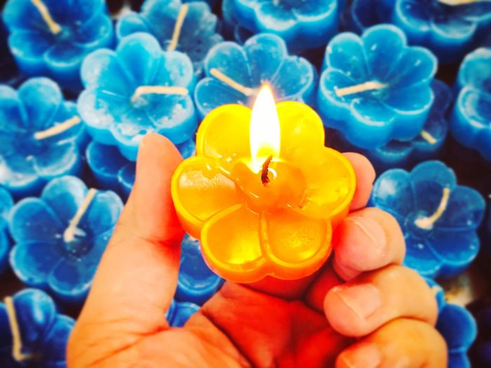 Candle on fire is in a hand so beautiful Human Hand Unrecognizable Person Holding Human Finger One Person Human Body Part Real People Close-up Personal Perspective Freshness Flower Flame Outdoors Day