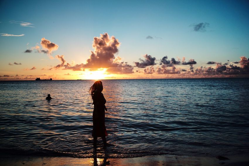 Water Sky Sunset Sea Scenics - Nature Beauty In Nature Silhouette Tranquility Tranquil Scene Beach Cloud - Sky Nature Horizon Over Water Horizon Reflection Orange Color Leisure Activity One Person Outdoors Land
