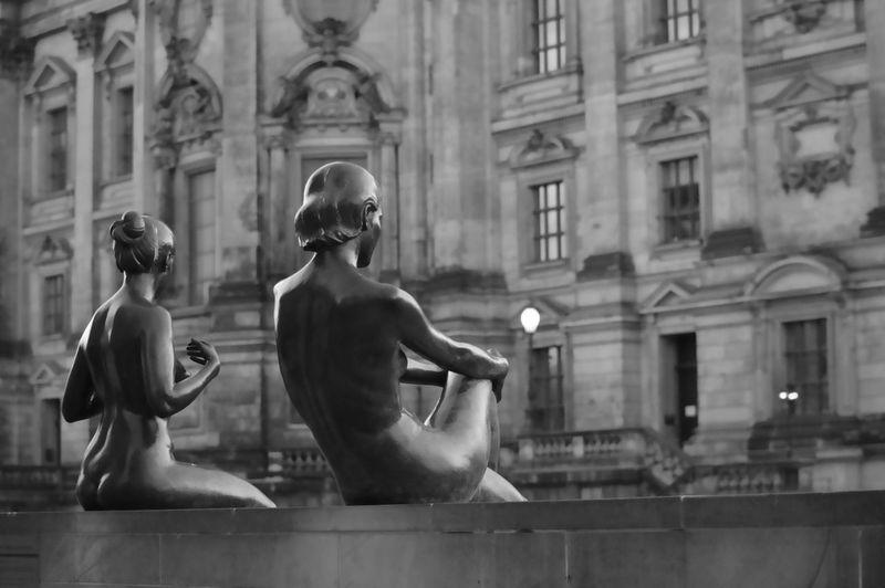 Sculptures against historic building